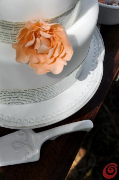 Il fiore sulla torta per il matrimonio in arancio