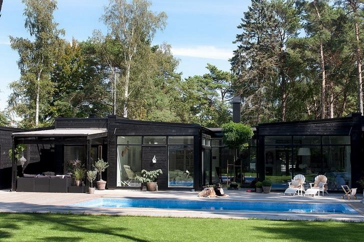 villetta_schiera_legno_giardino_piscina_coperta